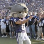 Willie the Wildcat, K-State's mascot, energizes the crowd during a recent football game in Manhattan. K-State and KU fans remain on edge as they wait for the fate of the Big 12 to be announced. Representatives from both schools expressed optimism Wednesday about the conference's future.  File photo