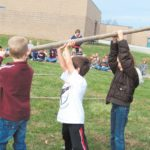 Spring Hill Elementary School students work to build a teepee while learning about American Indian culture last winter. School districts are awaiting late funding payments from the state. File photo