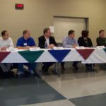 Gardner City Council candidates (from left) Jared Taylor, Larry Fotovich, Dustin Martin, Chris Morrow, Dennis Pugh, Tory Roberts, Bill Sutton and Jeff Barber await their turn at the microphone during a city council candidate forum Saturday morning. Staff photo by Danedri Thompson
