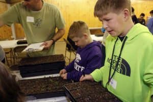 Colby Short, 8 and his brother Ethan Short, 10, working at the seed planting party for Gardner Community Garden. About 45 attended the event at the Grange building on March 11.