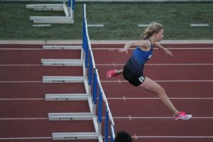 Senior Abbie Lane clocked 52.29 in the 300 hurdles to take third place at the Olathe Invitational last Friday. The Blazers return to the Olathe district activity center Friday for a mid season classic.
