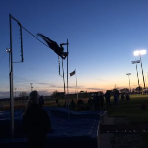 Davis Tropansky clears 13 feet to win the pole vault  event at the Olathe Invitational last week .It was a personal record for Tropansky. Submitted photo