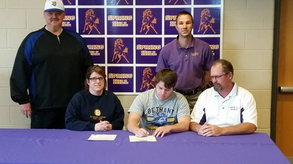 Reinking signs track letter with Bethany College