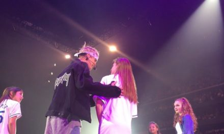 Local Girl performs onstage with Bieber