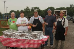 Pictured are Charlie Troutner, Cindy Crooks, Jodey Brown, Darius Crist and Clay Longnecker, Edgerton council members, at the July 3 community picnic. Photo courtesy of Alyann Photography