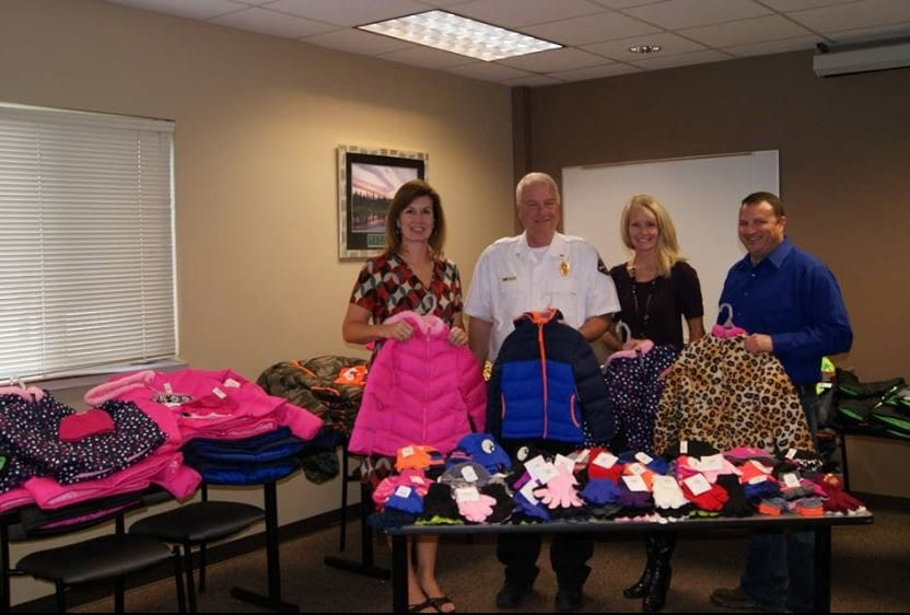 Johnson County Fire District # 1 collect coats for USD 231