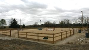 The newly built, lighted riding arena at Capall Equestrian Center in Gardner extends short winter days and provides a sure footed surface for horses. Photo courtesy of Rick Poppitz