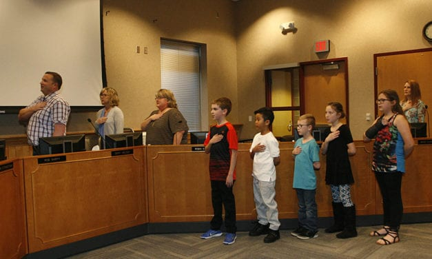 Sunflower students the lead the Pledge of Allegiance