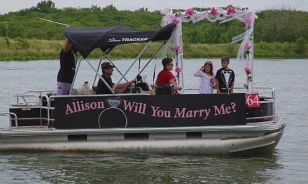 Surprise marriage proposal delivered by boat at Gardner Lake