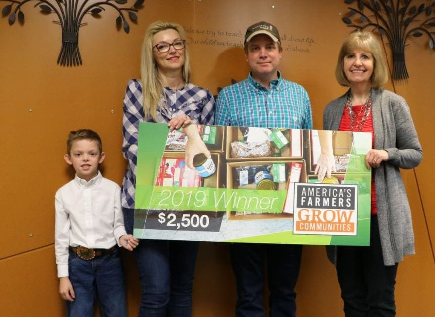 Area farmers give donation to Edgerton Elementary