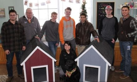 Students build dog houses for local community