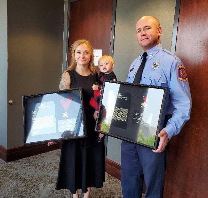Commission honors couple for river rescue